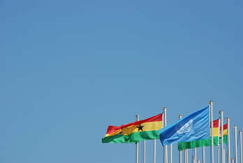 Ghanaian and UN flag outside confernce center