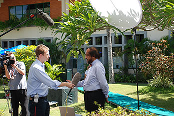 IPCC Chairman Dr. Rajendra Pachauri giving media interviews outside the conference venue