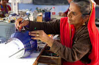 Woman from India repairs solar powered lamp