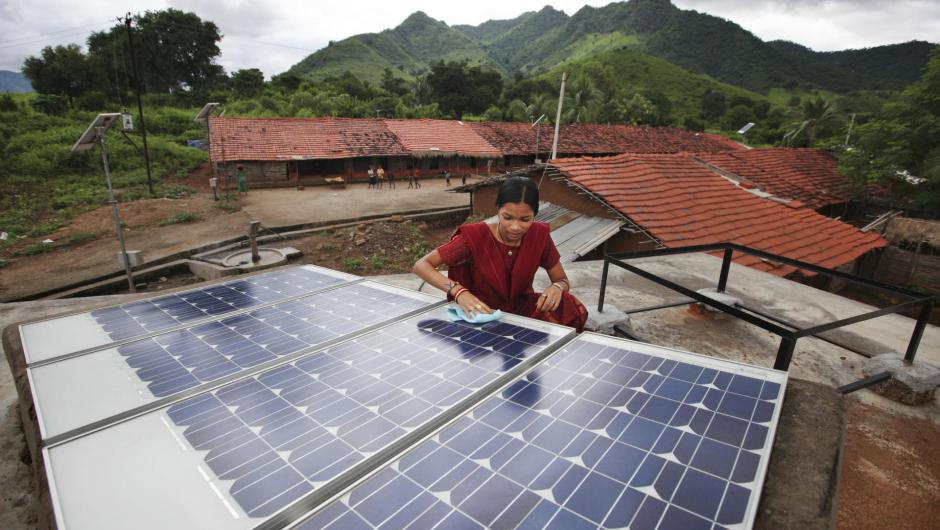 Woman with solar panels in India
